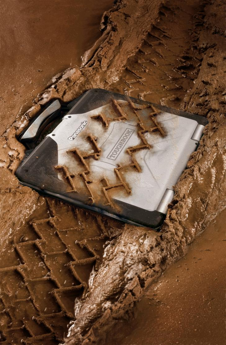 TOUGHBOOK covered in mud with tyre tracks