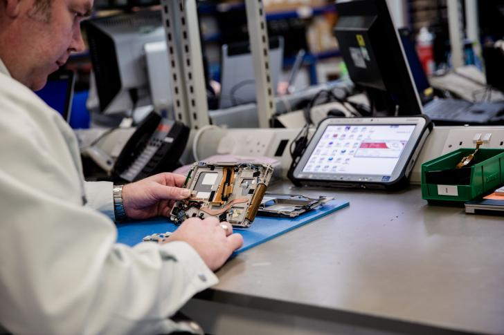 A key worker mobile computing device being repaired in the TOUGBOOK European Service Centre in Cardiff