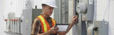 A construction worker holding a TOUGHBOOK