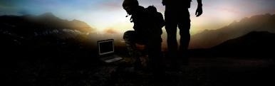 Soldiers on a battlefield with a TOUGHBOOK
