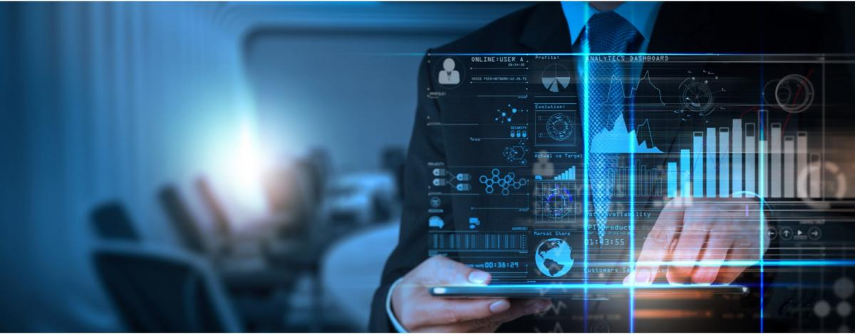Man holding mobile device with graphs and analytical style symbols around him stock image by Peshkova/shutterstock.com